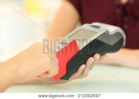 Seller Using A Dataphone With A Credit Card In A Store