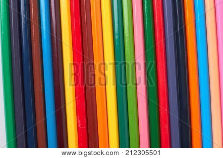 Multicolored pencils background. Background of colored wooden pencils for art.