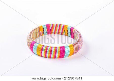 Cute vivid color bracelet. Girl trendy bangle isolated on white background. Multicolored stripes female bracelet.