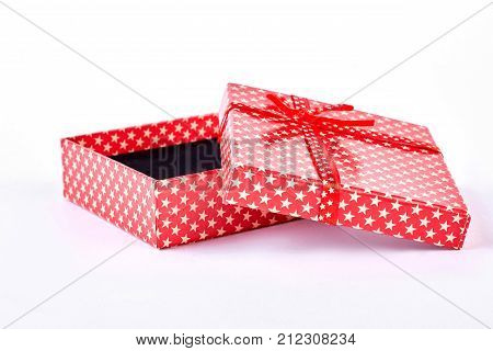 Open red gift box. Opened red present box, white background. Christmas and holidays concept.