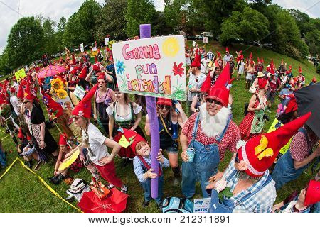 ATLANTA, GA - APRIL 2017: Dozens of people dressed like gnomes gather at Inman Park to attempt a world record for most gnomes gathered in one place on April 29 2017 in Atlanta GA.
