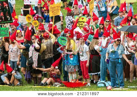 ATLANTA, GA - APRIL 2017:  A huge group of people dressed like gnomes gather at Inman Park to attempt a world record for most gnomes gathered in one place in Atlanta GA on April 29 2017.