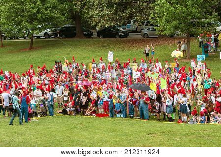 ATLANTA, GA - APRIL 2017: A large group of people dressed as gnomes gather at Inman Park to try and break the world record for gnomes in one place in Atlanta GA on April 29 2017.