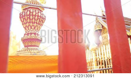 Golden Buddhist bell for prayer wishes in sunlight at Wat Phra That Doi Suthep temple Chiang Mai Thailand. Wat Phra That Doi Suthep is popular famous tourist temple attraction landmark in Chiangmai