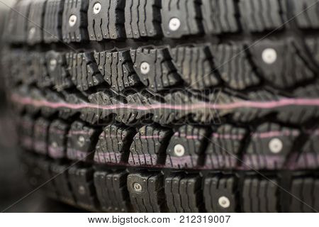 Studded tire on a background winter studded tires for a car new close-up
