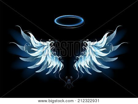 Light artistic blue angel wings on a black background. Angel wings.