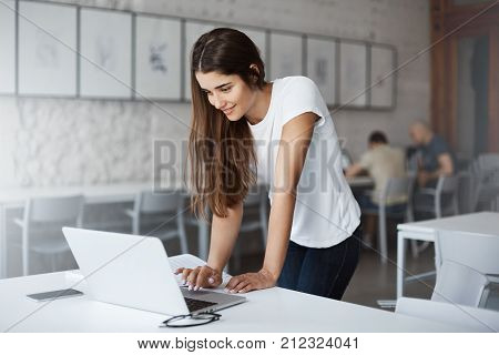 Woman using laptop computer to fill her online shopping basket to checkout on black friday sales.