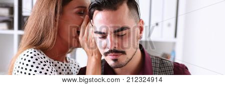 Woman gossip whispers in the ear of news to a man in office poster