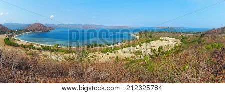 Panoramic view of Gili Gede tropical lagoon beach with tranquil turquoise water on Asahan Layar and Lombok islands background. Indonesia. Bali popular travel destination. Summer holiday in Indonesia.
