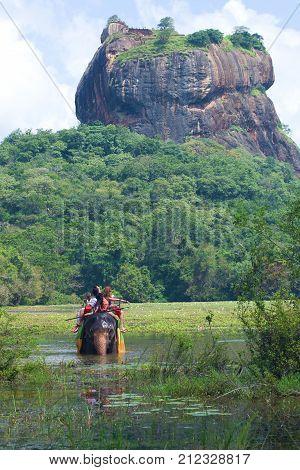 SIGIRIYA, SRI LANKA - MARCH 16, 2015: Elephant safari at the foot of Sigiriya mountain