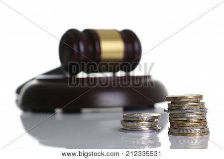 Judge hammer with stand isolated on white background with tower coins for making decisions disputes arbitration court lawfulness actions of lawyers prosecutor lawyer bringing to order and bribe.