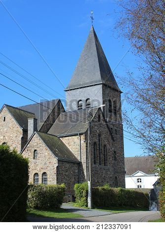The church of Roumont, situated in the quaint hamlet of Roumont-sur-Ourthe in the province of Luxembourg in the Belgian Ardennes.