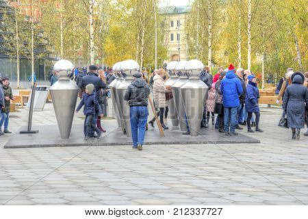 MOSCOW RUSSIA - November 04.2017: Zaryadye Park Visitors having fun in funny installation Echo