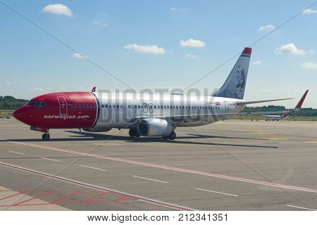 MILAN, ITALY-SEPTEMBER 17, 2017: Norwegian Air Shuttle Boeing 737-8JP (LN-DYD) with Hans Christian Andersen's portrait on the taxiway of Malpensa Airport