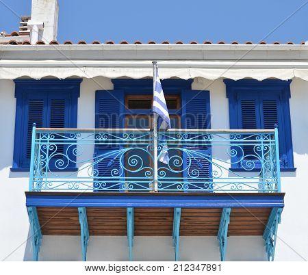 Skiathos Greek Island House Facade with Greek Flag