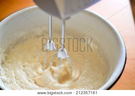 on a photo whipping with a dough mixer for pancakes