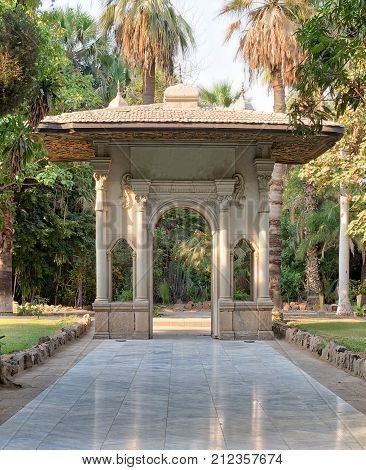 Porte-cochere (carriage porch Gate) at a public park with marble tiled floor trees and palms Cairo Egypt