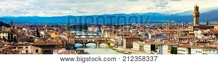 Florence, Italy. Aerial view of Florence, Italy. All major landmarks - Pitti Palace, Old Bridge and mountains at the background