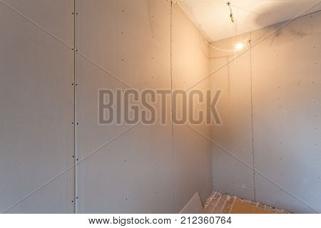 Interior of upgrade apartment with materials during on the remodeling renovation extension restoration reconstruction and construction. ( making wall from gypsum plasterboard)