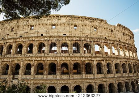 Rome Italy - September 2 2017 : One of the most popular travel place in world - Roman Coliseum . A view from the outside .