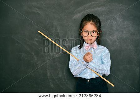 Beautiful Little Teacher Pointing Someone Rebukes