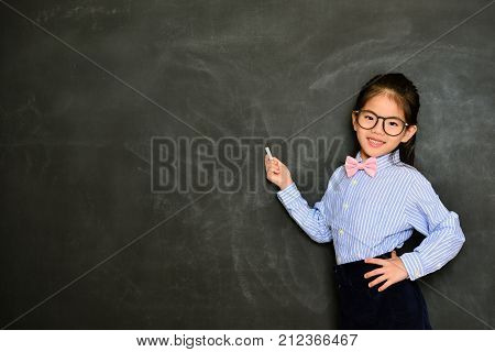 Smiling Little Teacher Standing In Blackboard