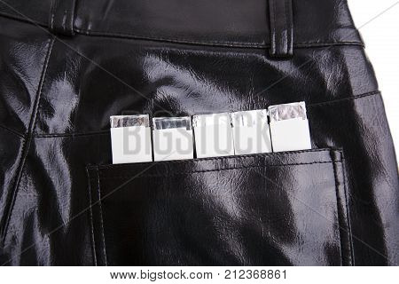 Chewing gums in the back pocket of black pants
