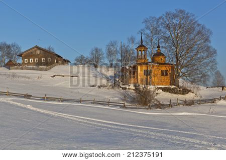 Wintry rural landscape with chapel. Chapel of the Assumption Mother of God in a village Markovskaya Verkhovazhsky District Vologda Region, Russia