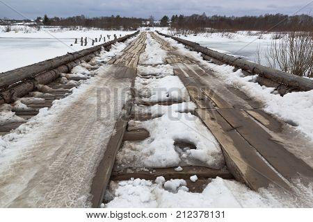 Wooden road bridge across river Vaga near the village Klopovskaya, Velsky District, Arkhangelsk region, Russia