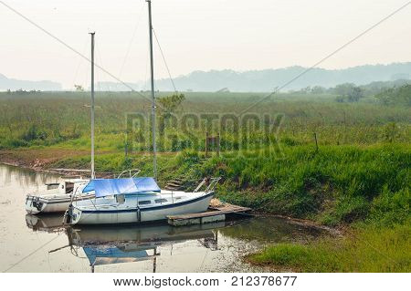 Boats and hazy landscapes of Lake de Yojoa in Western Honduras. Central America