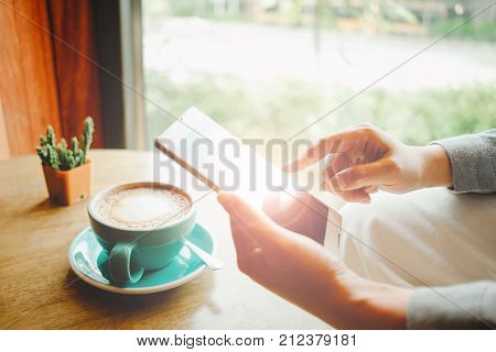 Business Woman Hold Smart Phone On Left Hand And Her Use Right Hand For Touch On Screen. Cup With Co