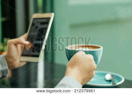 Hand Of Business Woman Hold Smart Phone On Left Hand And Use Right Hand For Grab Cup Of Coffee Place
