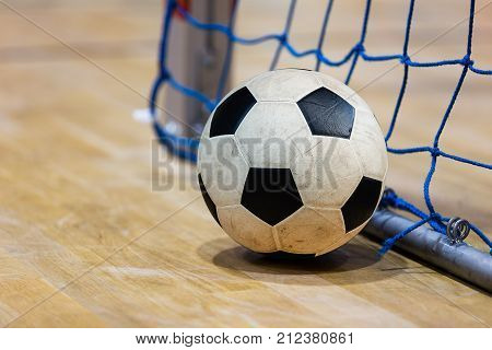 Football futsal ball goal and floor. Indoor soccer sports hall. Sport Futsal background. Indoor Soccer Winter League