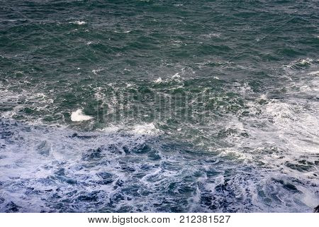 A rough sea background with breaking waves