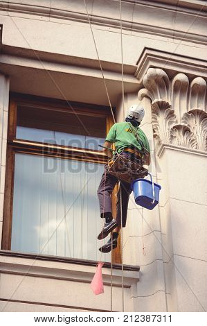 Male Mountain Climber Window Cleaner