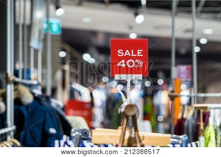sale 40% off mock up advertise display frame setting over the clothes line in the shopping department store for shopping business fashion and advertisement concept% off mock up advertise display frame setting over the clothes line in the shopping departme