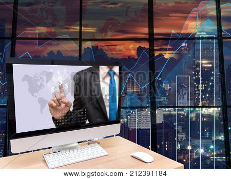 the computer on the wood table with Businessman point sign of money at the screen in front of the glass window over on the trading graph over the blurred photo of cityscape background, 3D illustration