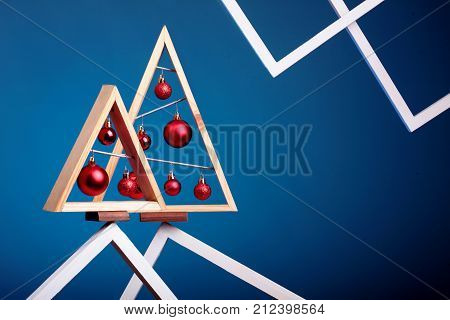 Christmas Background With Modern Christmas Tree Made Of Wooden Desk On Blue Background Stay On Top O