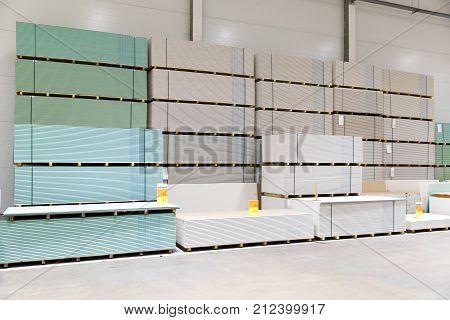 gypsum board plasterboard stacks at indoor warehouse
