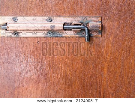 Old metal latch with the copy space for lock the bedroom of the countryside house.