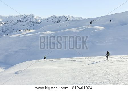 Couple hiking with snowshoes in winter mountain landscape. Alps in Germany, Bavaria, Allgau.