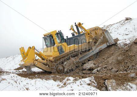 Heavy bulldozer in open pit