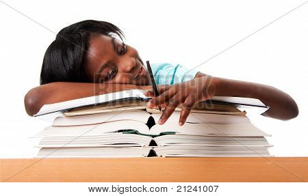 Student tired of doing homework studying with pen laying unmotivated on stack open books isolated. poster
