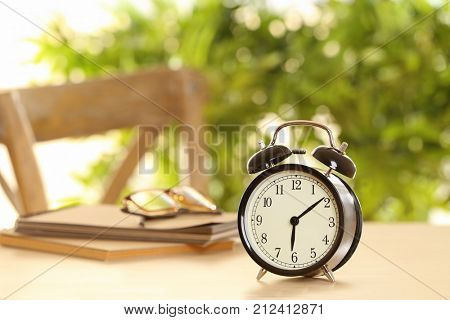 Alarm clock on table indoors. Morning routine concept