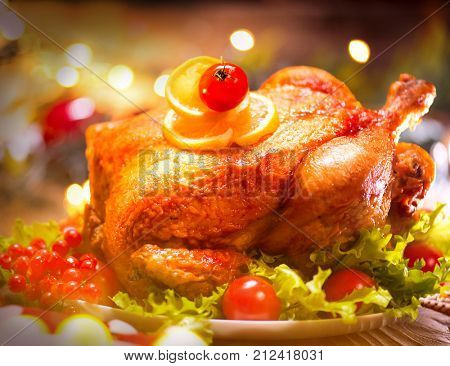 Thanksgiving dinner, Thanksgiving turkey. Served table. Thanksgiving table served with turkey, decorated. Roasted turkey, table setting closeup