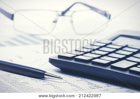 Financial accounting Pen and calculator on the balance sheets