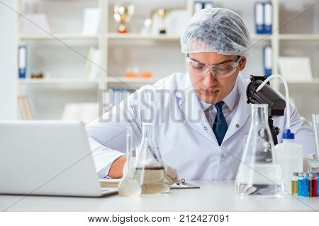 Young researcher scientist doing a water test contamination expe