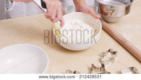 Mixing dough to make cookies
