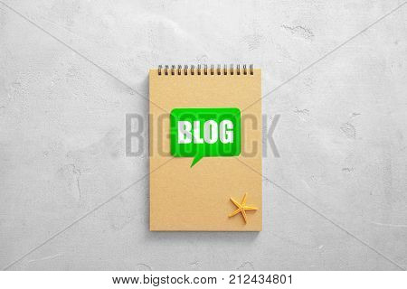Notebook with word BLOG on light background
