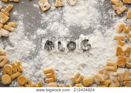 Word BLOG made from shapes for cookies on table
